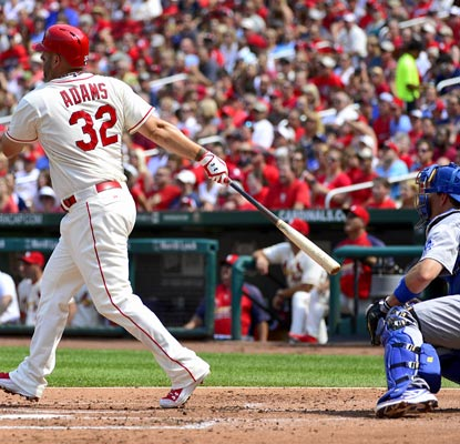 Matt Adams connects for a two-run home run in the first inning against the Dodgers in St. Louis.   (USATSI)