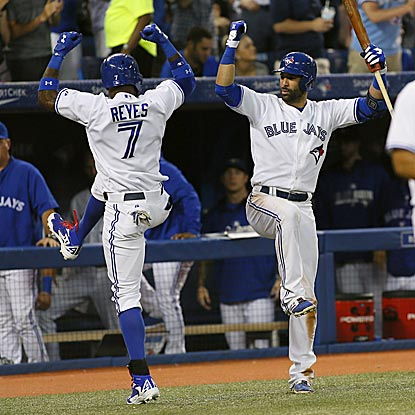 Jose Reyes and Jose Bautista do a jig after Reyes cracks a home run in the sixth inning.  (USATSI)