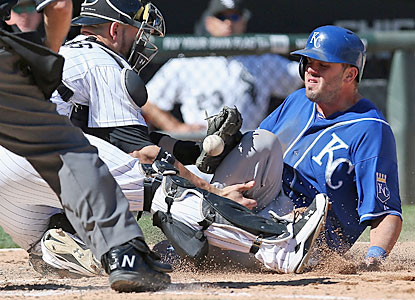 Mike Moustakas, who hits a leadoff single in the ninth, scores the go-ahead run for the Royals. (Getty Images)