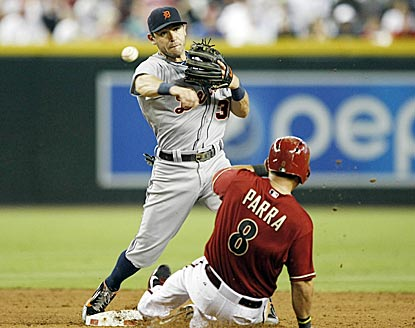 Arizona native Ian Kinsler turns a double play for Detroit even with Gerardo Parra bearing down on him.  (USATSI)