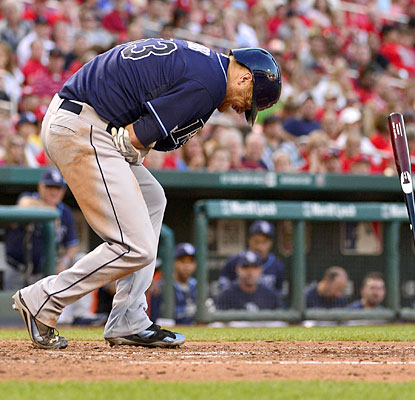 Alex Cobb endures a scary moment at the plate, getting hit in the pitching elbow. He stays in, and goes on to win. (USATSI)