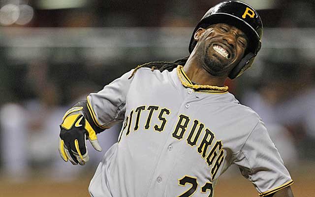 Andrew McCutchen grimaces in pain after being struck in the back by a 95-mph fastball.(USATSI)