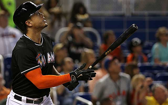 Giancarlo Stanton hits a monstrous home run against the Braves. (Getty)