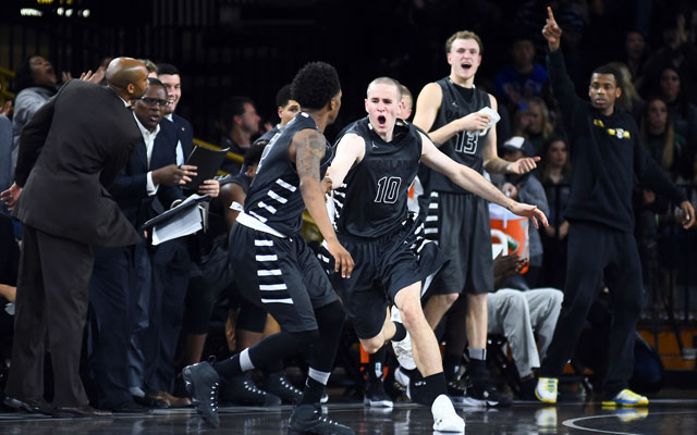 Oakland's Max Hooper (10) celebrates with his teammates earlier this season. (USATSI)