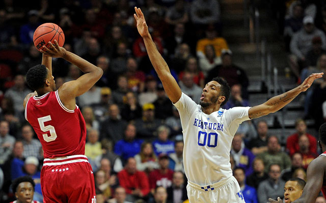 Indiana's Troy Williams and Kentucky's Marcus Lee would be wise to return for another year of college. (USATSI)