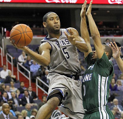Austin Freeman leads the Hoyas in scoring, but looks to get teammates involved on this play.  (AP)