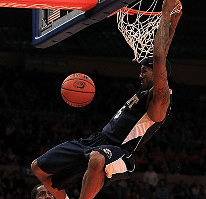 Pittsburgh's Gilbert Brown dunks for two of his 11 points against Maryland. (Getty Images)