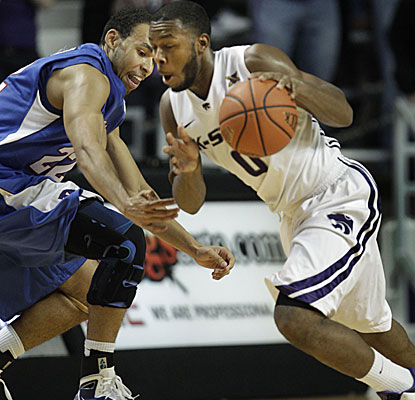 Kansas State guard Jacob Pullen steals the ball from Presbyterian's Josh Johnson and goes on to score 15 points. (AP)