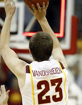 Jamie Vanderbeken still has his hands on the ball as the backboard lights up. (AP)