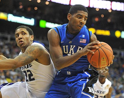 Duke freshman guard Kyrie Irving beats Kansas State guard Rodney McGruder to a rebound during the second half.  (US Presswire)