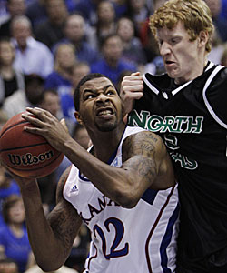 Kansas' Marcus Morris will battle a fellow 6-foot-8 forward in Arizona's Derrick Williams this weekend. (AP)