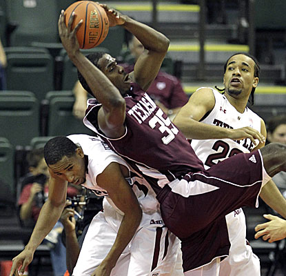 Texas A&M forward Ray Turner grabs one of his 12 rebounds over Temple's Ramone Moore, left, and Aaron Brown. (AP)