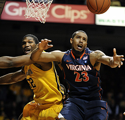 Minnesota's Trevor Mbakwe, left, and Virginia's Mike Scott battle for a rebound Monday. (AP)