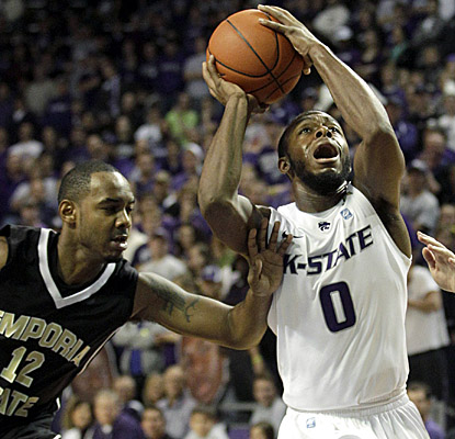 Jacob Pullen battles in traffic Monday vs. Emporia State. The senior guard now owns K-State's career 3-pointers record. (AP)