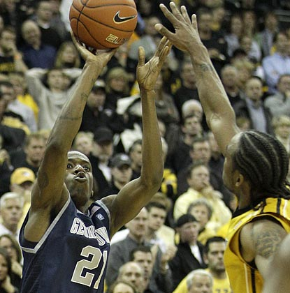 Jason Clark, shown shooting over Marcus Denmon, almost single-handedly defeats Mizzou in overtime with his 3-point shooting.  (AP)