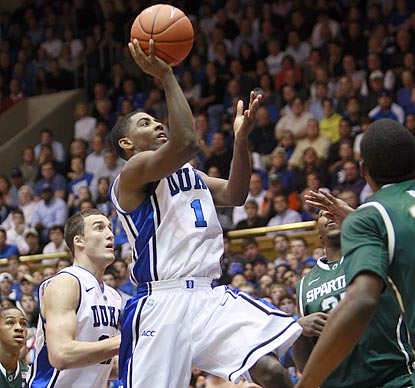 Duke freshman Kyrie Irving drives in for two of the 18 points he scores in the first half.  (AP)