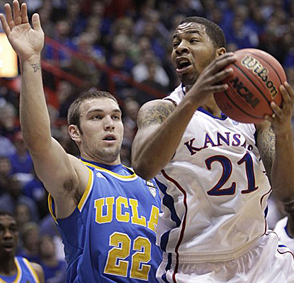 Kansas forward Markieff Morris, who finishes with nine points, drives to the basket while covered by UCLA's Reeves Nelson. (AP)
