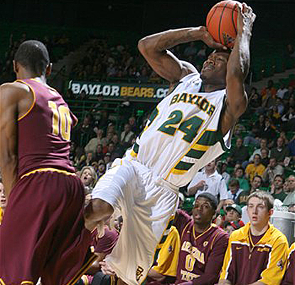 Baylor's LaceDarius Dunn, the game's leading scorer with 24 points, falls backward while shooting. (Getty Images)