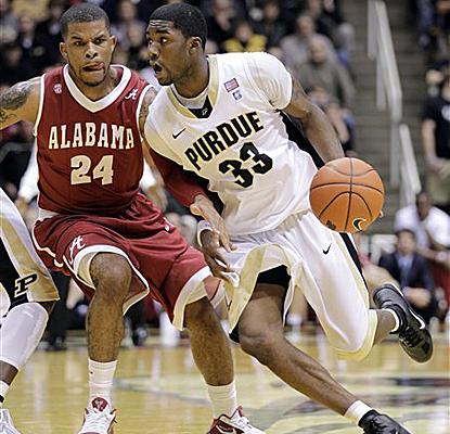 Purdue guard E'Twaun Moore drives on Alabama guard Charvez Davis on his way to scoring 23 points. (AP)