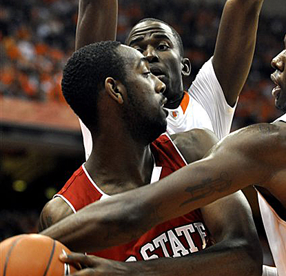 Syracuse's Baye Moussa Keita and Rick Jackson pressure N.C. State's C.J. Leslie as the Orange stave off the Wolfpack. (AP)
