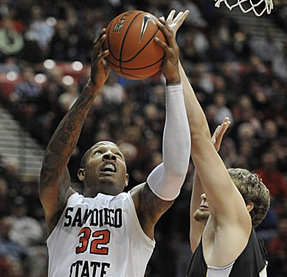 Billy White shoots over Garrett Stutz as he contributes to San Diego State's second-half run that seals the win. (AP)