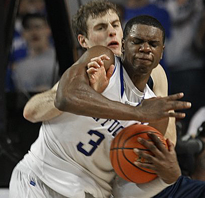 Kentucky's Terrence Jones is fouled by Notre Dame's Tim Abromaitis and goes on to lead his team with 27 points. (AP)