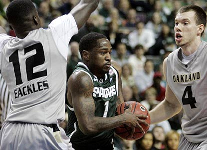 Kalin Lucas, whose late heroics give the Spartans the slim margin, works on a 25-point game. (AP)
