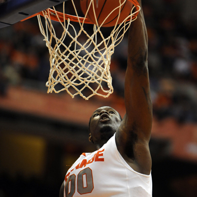 Syracuse's Rick Jackson slams home two of 18 points during a lopsided game against Colgate.  (Getty Images)