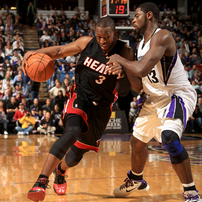 Dwyane Wade drives around Tyreke Evans on his way to score a game-high 36 points.  (Getty Images)