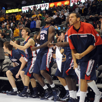 The Gonzaga Bulldogs react after teammate Kelly Olynyk drains a go-ahead three-pointer late in the second half.  (AP)