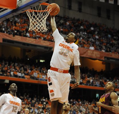 Syracuse's Kris Joseph goes up for two of his 21 points that help the Orange stay perfect this season. (US Presswire)