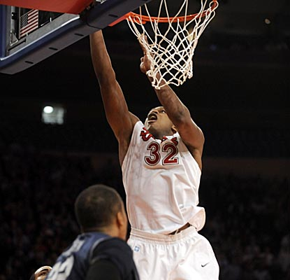 St. John's Justin Brownlee scores on the putback to help the Red Storm put Georgetown away. (AP)