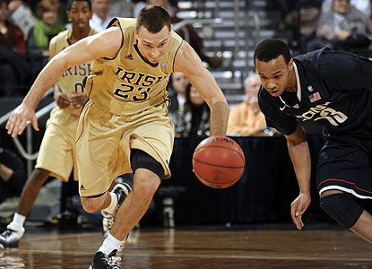 Ben Hansbrough, chasing a loose ball, leads the way for the Irish with 21 points. (AP)