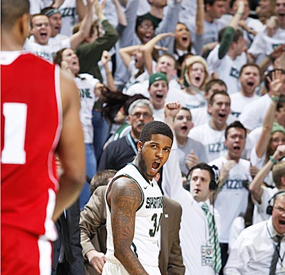 The Spartans' Korie Lucious drains a 3-pointer in the final minute of regulation to force overtime in East Lansing. (AP)