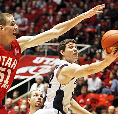 Jimmer Fredette goes off for 32 points in the first half, capping the outburst with a 40-footer at the buzzer. (AP)