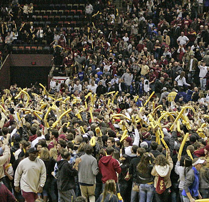 Fans mob the court moments after Florida State drops a top-ranked Duke team at home for the third time since 2002.  (AP)