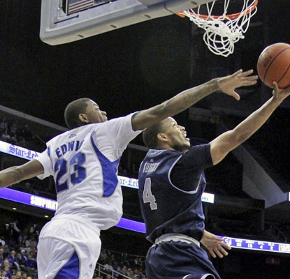 Hoyas guard Chris Wright goes up and under for two and hits four late free throws to ice the win. (US Presswire)