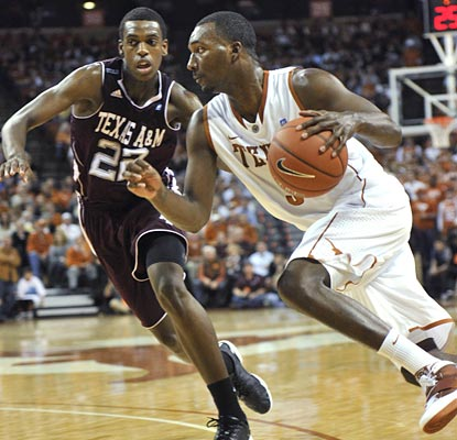 Jordan Hamilton leads the way for the Longhorns as they bring an end to the Aggies' 13-game winning streak.  (AP)