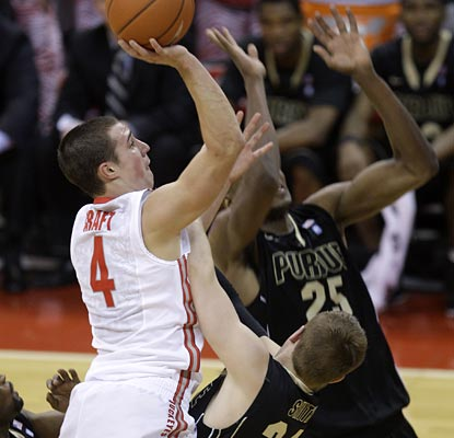 Aaron Craft attacks the rim on his way to becoming one of six Buckeyes in double digits, scoring 11 on the night.  (AP)