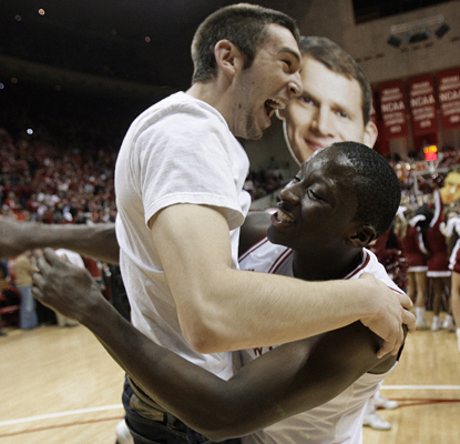 Indiana guard Victor Oladipo (right) celebrates with a fan after the Hoosiers upset No. 20 Illinois.  (AP)