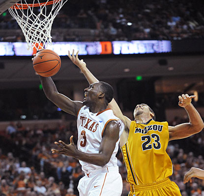 Jordan Hamilton (3) pulls down one of his career-best 13 rebounds as he also contributes for the Longhorns with 16 points. (US Presswire)