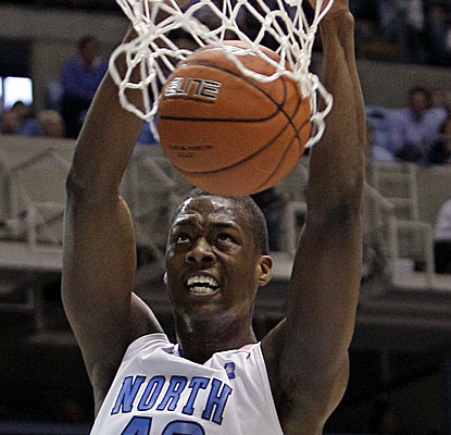 North Carolina freshman forward Harrison Barnes dunks on the Seminoles on Sunday. (AP)