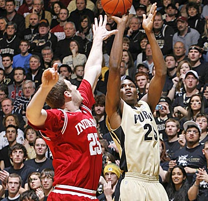 Purdue's JaJuan Johnson shoots over Indiana's Tom Pritchard for two of his 15 points to earn a win on his birthday.  (US Presswire)