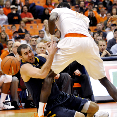 West Virginia's Cam Thoroughman meets a wall named Baye Moussa Keita who scores nine points in his first start of the season.  (AP)