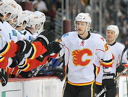 Anton Babchuk and the Flames get plenty of opportunities to practice their postgoal hand-slapping routine.  (AP)