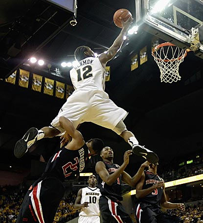 Missouri's Marcus Denmon soars over Texas Tech's John Roberson in the second half for two of his team-high 20 points.  (Getty Images)
