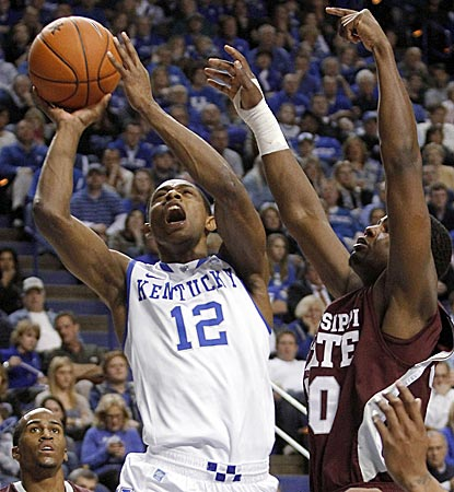 Brandon Knight, who winds up with a game-high 24 points, shoots under pressure from MSU's Wendell Lewis in the second half.  (AP)
