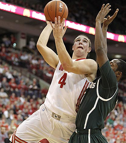 Aaron Craft, shown driving against Michigan State's Kalin Lucas, comes off the bench to lift the Buckeyes late in the game.  (Getty Images)