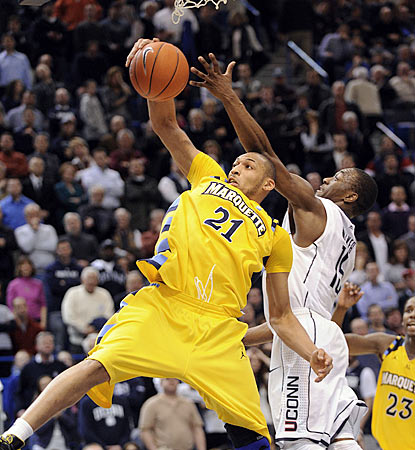 Marquette's Joseph Fulce (21) one-hands a rebound in front of Connecticut's Kemba Walker during the second half.  (AP)