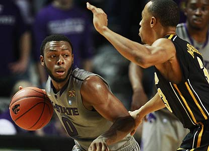 Jacob Pullen scores 24 points en route to becoming one of two K-State players to go over the 2,000-point mark. (AP)